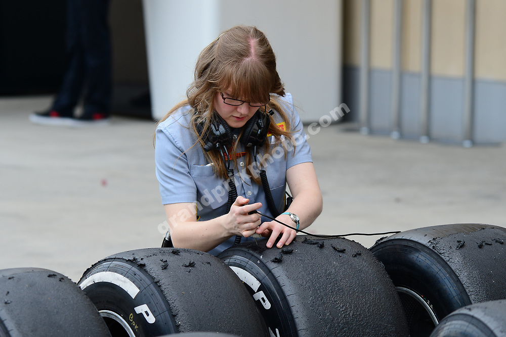 Pirelli tyre technician at work after practice before the 2016 Bahrain Grand Prix. Photo: Grand Prix Photo