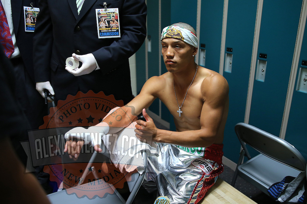 """Guillermo Avila gets ready in the dressing room during the """"Boxeo Telemundo"""" boxing match at the Kissimmee Civic Center on Friday, March 14, 2014 in Kissimmme, Florida. (Photo/Alex Menendez)"""