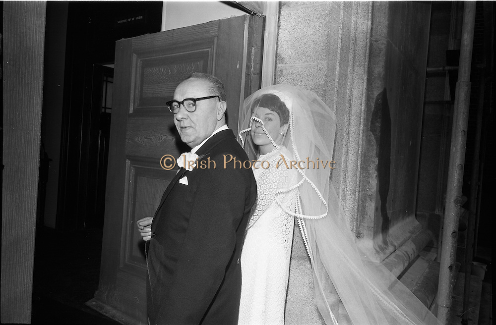"""16/09/1967<br /> 09/16/1967<br /> 16 September 1967<br /> Wedding of Mr Francis W. Moloney, 28 The Stiles Road, Clontarf and Ms Antoinette O'Carroll, """"Melrose"""", Leinster Road, Rathmines at Our Lady of Refuge Church, Rathmines, with reception in Colamore Hotel, Coliemore Road, Dalkey. Image shows the bride entering the church before  the ceremony with her father Mr Dudley O'Carroll."""