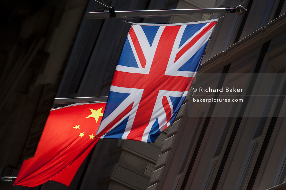 The Chinese and British national flags hanging together in a City of London sidestreet.