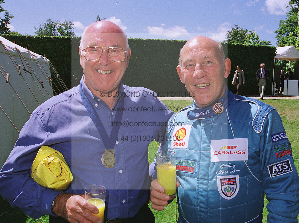 Left to right, motor racing commentator MURRAY WALKER and racing driver STIRLING MOSS, at a car rally in West Sussex on 20th June 1999.MTM 24