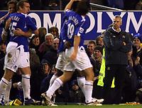 Photo: Paul Thomas.<br /> Everton v West Ham United. The Barclays Premiership. 03/12/2006.<br /> <br /> Alan Pardew, manager of West Ham watches Everton celebrate James Vaughans goal.