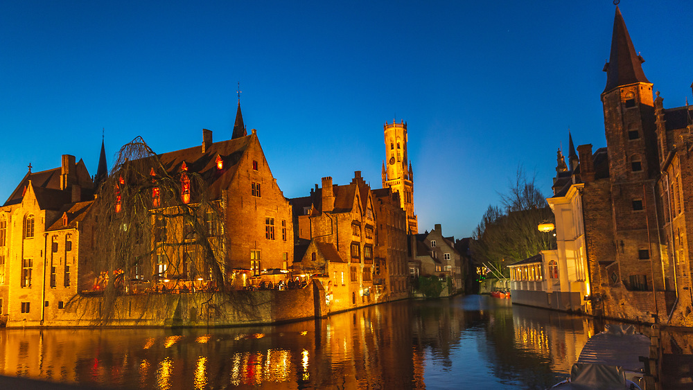 A familiar, and still beautiful shot of Bruges at night over the canal
