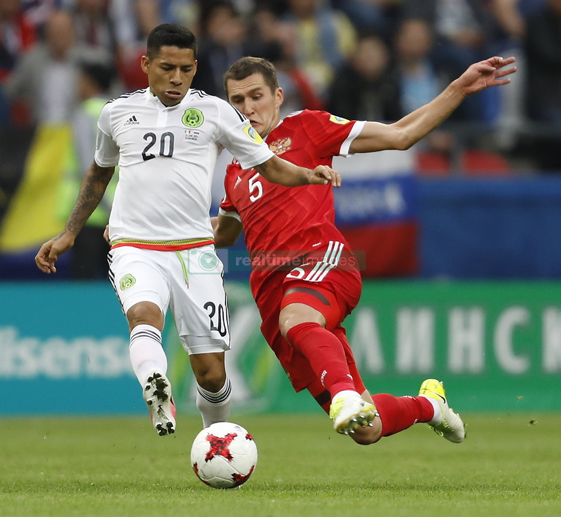 June 24, 2017 - Kazan, Russia - Viktor Vasin (R) of Russia national team and Javier Aquino of Mexico national team vie for the ball during the Group A - FIFA Confederations Cup Russia 2017 match between Russia and Mexico at Kazan Arena on June 24, 2017 in Kazan, Russia. (Credit Image: © Mike Kireev/NurPhoto via ZUMA Press)