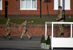 The Prince of Wales, Colonel Welsh Guards, watches a parade as he attends Elizabeth Barracks in Woking to present campaign medals to soldiers from the 1st Battalion Welsh Guards following their return from Afghanistan.