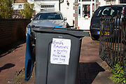 Local response to Coronavirus is felt on a street by street level with some generous home owners leaving out a recycling bin full of home grown potatoes for thei neighbours to take for free on 28th March 2020 in Birmingham, England, United Kingdom. Coronavirus or Covid-19 is a new respiratory illness that has not previously been seen in humans. While much or Europe has been placed into lockdown, the UK government has announced more stringent rules as part of their long term strategy, and in particular social distancing.