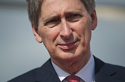 © London News Pictures. 11/07/2012. Farnborough, UK. Defence Secretary Philip Hammond  officially receiving first Wildcat helicopters from AgustaWestland on behalf of the armed forces on day three of the Farnborough International Airshow, in Farnborough, Hampshire, UK on July 9, 2012. FIA is a seven-day international trade fair for the aerospace industry which is held every two years at Farnborough Airport . Photo credit: Ben Cawthra/LNP.