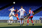 Kun Temenuzhkov of Leeds United U23 heads the ball under pressure during the U23 Professional Development League match between U23 Crystal Palace and Leeds United at Selhurst Park, London, England on 15 April 2019.