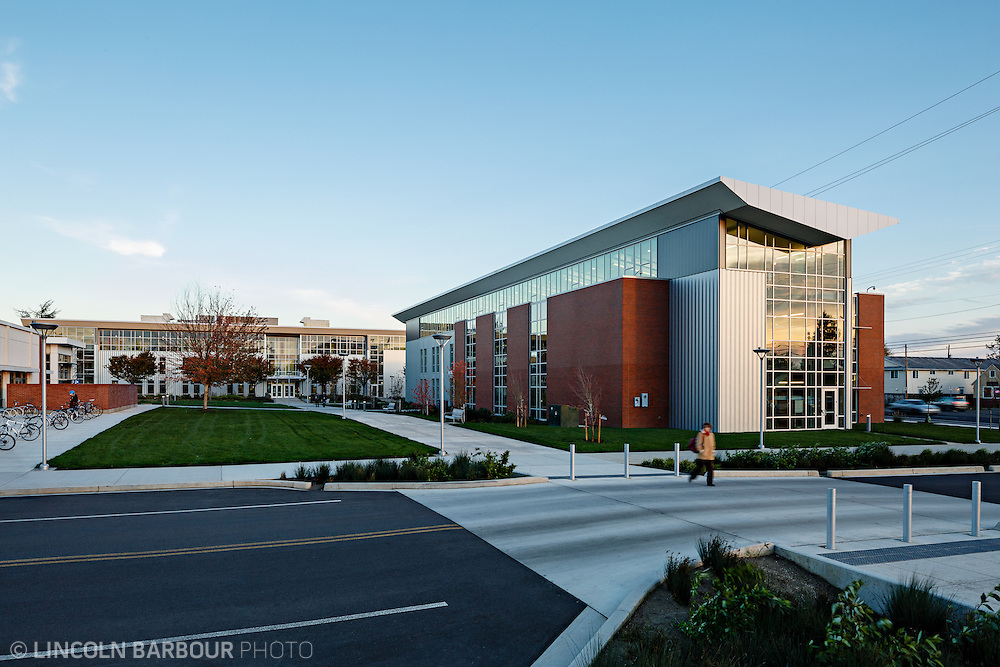 A modern looking community college building in the late afternoon.