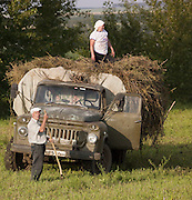 Farm workers with old truck, Perm, Russia.
