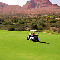 USA, Arizona, Fountain HIls. Red Mountain looms over We-Ko-Pa Golf Course in Fountain Hills