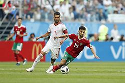 (l-r) Masoud Shojaei of IR Iran, Mbark Boussoufa of Morocco