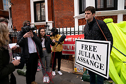 © Licensed to London News Pictures. 11/04/2019. London, UK. A pro-Assange demonstrator speaks to media outside the Ecuador Embassy. This morning Wikileaks founder Julian Assange was arrested by police and taken to a central London police station after living in the Ecuador Embassy in London since 2012. Photo credit : Tom Nicholson/LNP