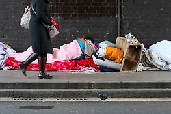© Licensed to London News Pictures. 14/12/2018. London, UK. A homeless man sleeps on the street under Harringay Green Lanes bridge in north London, where up to four people have been seen sleeping. More than 24,000 people in Britain will spend Christmas sleeping rough according to new figures by charity Crisis. Research commissioned by the charity shows that the number of homeless people has risen sharply in England and Wales between 2012 and 2017. It has gone up by 120% in England and 63% in Wales, compared to a fall of 6% in Scotland. With temperatures expected to drop below freezing in the capital, Mayor Sadiq Khan announced that cold-weather shelters would be open citywide. Photo credit: Dinendra Haria/LNP