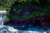 West Nusa Tenggara, Sumbawa. A cave carved by the ocean waves (from helicopter).