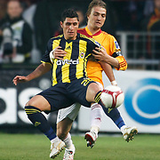 Galatasaray's Caner ERKIN (B) and Fenerbahce's Ozer HURMACI (F) during their Turkish superleague soccer derby match Galatasaray between Fenerbahce at the AliSamiYen Stadium at Mecidiyekoy in Istanbul Turkey on Sunday, 28 March 2010. Photo by Aykut AKICI/TURKPIX