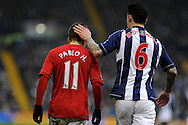 Swansea city's Pablo Hernandez (l) gets a pat on the head by West Brom's Liam Ridgewell. Barclays Premier league, West Bromwich Albion v Swansea city at the Hawthorns stadium in West Bromwich, England on Saturday 9th March 2013.  pic by  Andrew Orchard, Andrew Orchard sports photography,