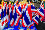 24 NOVEMBER 2012 - BANGKOK, THAILAND:  Thai flags for sale during a large anti government, pro-monarchy, protest  on November 24, 2012 in Bangkok, Thailand. The Siam Pitak group, which sponsored the protest, cited alleged government corruption and anti-monarchist elements within the ruling party as grounds for the protest. Police used tear gas and baton charges againt protesters.       PHOTO BY JACK KURTZ