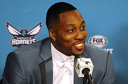 June 26, 2017 - Charlotte, NC, USA - The Charlotte Hornets' new center Dwight Howard talks to the media during a news conference on Monday, June 26, 2017 at the Spectrum Center in Charlotte, N.C. (Credit Image: © David T. Foster Iii/TNS via ZUMA Wire)