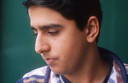Portrait of teenage boy looking sad,