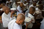 Women makes pray before eating their meal of rice at Angkor Wat, Siem Reap, Cambodia.