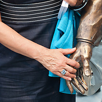 Participant holds the hand of the new statue of Ronald Reagan on the square named Freedom in Budapest, Hungary. Wednesday, 29. June 2011. ATTILA VOLGYI