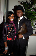 Shaznay Lewis with Chris Eubank, European premiere of Cirque de Soleil's Dralion, Royal Albert Hall and afterwards at the Natural History Museum, 8 January 2003.  .© Copyright Photograph by Dafydd Jones 66 Stockwell Park Rd. London SW9 0DA Tel 020 7733 0108 www.dafjones.com