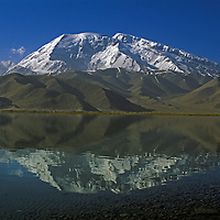 7,546-meter [Mount] Mustagh Ata reflects in Lake Karakul in the Pamir Mountains of Xinjiang Province in far-western China.