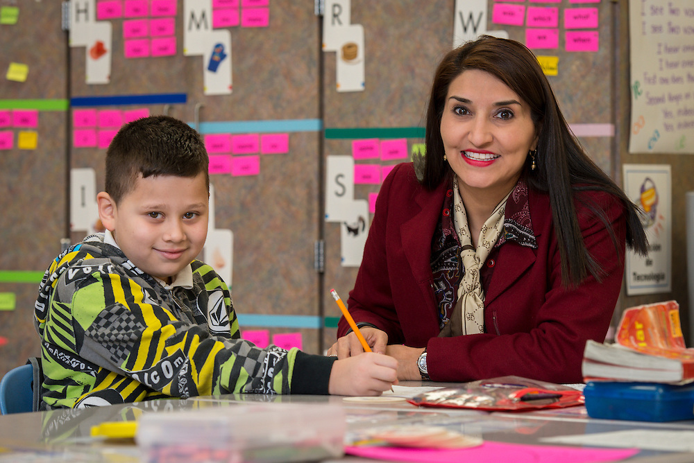 Angel Escobar-Larios and Magdalena Strickland pose for a photograph at Lantrip Elementary School, February 12, 2015.