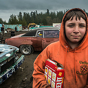 Dakota Lester works on Demolition derby cars at Peninsula Wrecking in Port Townsend, WA.