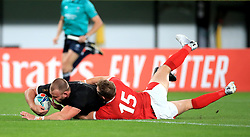 New Zealand's Joe Moody (left) scores his side's first try during the 2019 Rugby World Cup bronze final match at Tokyo Stadium.