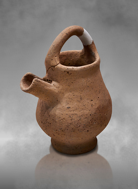 Hittite terra cotta side spout with strainer basket handle pitcher. Hittite Period, 1600 - 1200 BC, Ortakoy Sapinuva . Ortakoy Sapinuvwa . Çorum Archaeological Museum, Corum, Turkey. Against a grey bacground. .<br /> <br /> If you prefer to buy from our ALAMY STOCK LIBRARY page at https://www.alamy.com/portfolio/paul-williams-funkystock/hittite-art-antiquities.html  - Ortakoy  into the LOWER SEARCH WITHIN GALLERY box. Refine search by adding background colour, place, museum etc<br /> <br /> Visit our HITTITE PHOTO COLLECTIONS for more photos to download or buy as wall art prints https://funkystock.photoshelter.com/gallery-collection/The-Hittites-Art-Artefacts-Antiquities-Historic-Sites-Pictures-Images-of/C0000NUBSMhSc3Oo