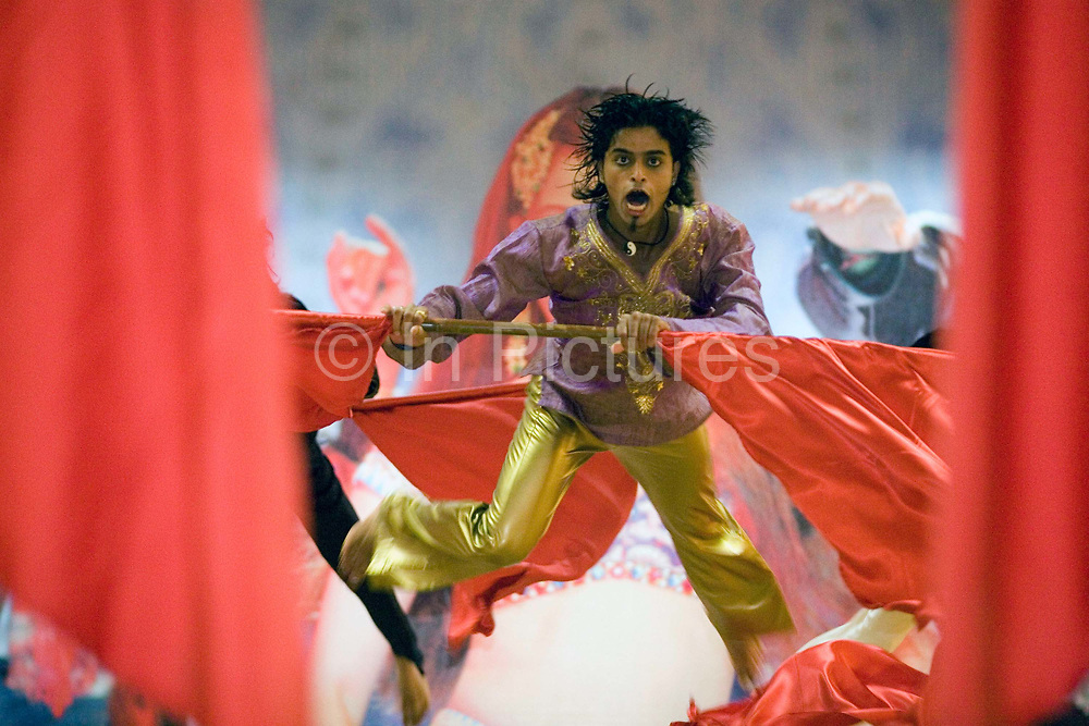 An actor leaps during a dance routine at a rehearsal of the show The Merchants of Bollywood in Mumbai, Indai<br /> <br /> The Merchants of Bollywood, An Indian theatrical dance musical, charts the history of the world's largest and most prolific film industry, and is loosely based on the showbusiness, Merchant family. Seen by over two million people worldwide, the show is homage to the world of Indian cinema.