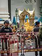 18 AUGUST 2015 - BANGKOK, THAILAND:  Thai police chief SOMYOT PUMPUNMUANG walks around the Erawan Shrine Tuesday during the investigation of the bombing of the shrine.  An explosion at Erawan Shrine, a popular tourist attraction and important religious shrine in the heart of the Bangkok shopping district killed at least 20 people and injured more than 120 others, including foreign tourists, during the Monday evening rush hour. Twelve of the dead were killed at the scene. Thai police said an Improvised Explosive Device (IED) was detonated at 18.55. Police said the bomb was made of more than six pounds of explosives stuffed in a pipe and wrapped with white cloth. Its destructive radius was estimated at 100 meters.   PHOTO BY JACK KURTZ