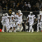 The South Florida sideline reacts after UCF Knights quarterback Blake Bortles (5) throws an interception late in the game during an NCAA football game between the South Florida Bulls and the 17th ranked University of Central Florida Knights at Bright House Networks Stadium on Friday, November 29, 2013 in Orlando, Florida. (AP Photo/Alex Menendez)