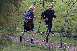 © Licensed to London News Pictures. 07/10/2020. London, UK. Prime Minister Boris Johnson goes for a morning run with his trainer Harry Jameson in Westminster. Later Mr Johnson will face MPs questions in Parliament. Photo credit: Peter Macdiarmid/LNP