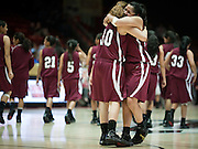 Summer Tallbull and Haley Taliman embrace after Shiprock defeated Portales 35-33 in the AAA semifinals Thursday morning in Albuquerque at The Pit.