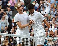Lawn Tennis - 2021 All England Championships - Week Two - Friday - Wimbledon<br /> Mens Semi Final - Novak Djokovic v Denis Shapovalov<br /> <br /> Denis Shapovalov congratulates Novak Djokovic at the net after the match<br /> <br /> <br /> Credit : COLORSPORT/Andrew Cowie