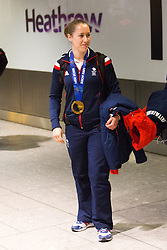 © Licensed to London News Pictures. 25/02/2014. London, UK. Womens skeleton gold medalist, Lizzy Yarnold waits for her team mates to catch her up at Heathrow Airport arrivals in London on 24th February 2014. Photo credit : Vickie Flores/LNP