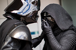 © Licensed to London News Pictures . 30/07/2017 . Manchester , UK . Darth Vader and Kylo Ren take a cigarette break outside the venue . Cosplayers, families and guests at Comic Con at the Manchester Central Convention Centre . Photo credit : Joel Goodman/LNP