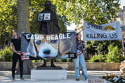 London, UK. 24th September, 2021. Animal rights activists calling for the closure of a site in Huntingdon which rears beagles for animal research take part in a protest in Parliament Square. The activists, who are based at a camp close to the MBR Acres site, protested outside the Home Office to call for an immediate review of all animal testing and vivisection and a moratorium on the use of dogs in research.