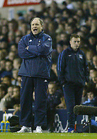 1/1/2005 - FA Barclays Premiership - Tottenham Hotspur v Everton - White Hart Lane<br />Tottenham Hotspur's coach Martin Jol shouts instructions to his players as Everton manager David Moyes stands silent in the background during Tottenham's 5-2 victory<br />Photo:Jed Leicester/Back Page Images