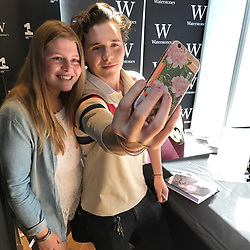 """Brooklyn Beckham releases a photo on Instagram with the following caption: """"Thanks to everyone I met today in Liverpool. So pleased you all came! London tomorrow! @waterstones #whatisee"""". Photo Credit: Instagram *** No USA Distribution *** For Editorial Use Only *** Not to be Published in Books or Photo Books ***  Please note: Fees charged by the agency are for the agency's services only, and do not, nor are they intended to, convey to the user any ownership of Copyright or License in the material. The agency does not claim any ownership including but not limited to Copyright or License in the attached material. By publishing this material you expressly agree to indemnify and to hold the agency and its directors, shareholders and employees harmless from any loss, claims, damages, demands, expenses (including legal fees), or any causes of action or allegation against the agency arising out of or connected in any way with publication of the material."""