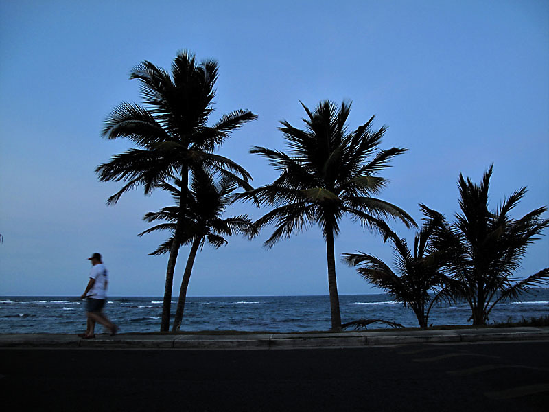 A couple walks near the beach in Luquillo at dusk in Puerto Rico..Photo by Angel Valentin, copyright 2009.