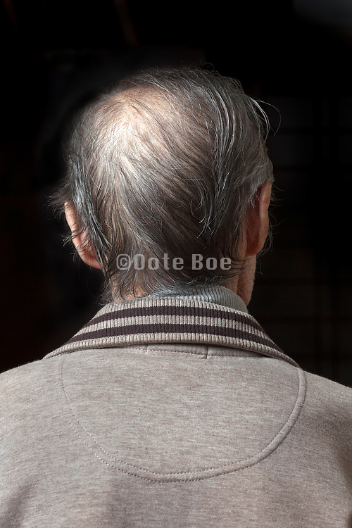 elderly man looking a way from the camera