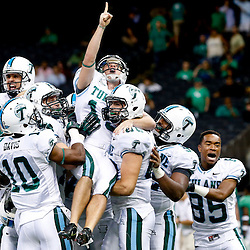 Oct 5, 2013; New Orleans, LA, USA; Tulane Green Wave kicker Cairo Santos (19) is held up by teammates as they celebrate a game winning field goal against the North Texas Mean Green during the fourth quarter at Mercedes-Benz Superdome. Tulane defeated North Texas 24-21.Mandatory Credit: Derick E. Hingle-USA TODAY Sports