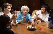 "Sean Knight plays ""Go Fish"" and drinks saki with partners and fellow chefs Cindy Pawlcyn and Ken Tominaga at Cindy's St. Helena home in the Napa Valley, CA. They are about to open a new restaurant in St. Helena, called Go Fish. Also playing is Ken's 9 year old son.."
