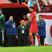 Turkey's Arda TURAN (R) and Croatia's coach Slaven BILIC (L) during their UEFA EURO 2012 Play-off for Final Tournament First leg soccer match Turkey betwen Croatia at TT Arena in Istanbul Nüovember11, 2011. Photo by TURKPIX