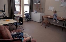 Children at Womens Aid refuge in kitchen Leeds UK