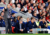 Photo: Glyn Thomas.<br />Liverpool v Blackburn Rovers. The Barclays Premiership.<br />15/10/2005.<br />Liverpool's manager Rafael Benitez (L) encourages his players as Blackburn manager Mark Hughes (second from L) looks unhappy.